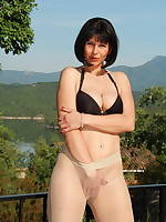 Transparent pantyhose and a black bra | PantyhoseDiva.com